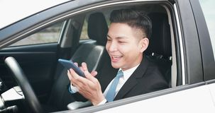 Man use phone in car royalty free stock images