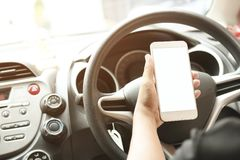 Man use phone and looking. On empty screen of mobilephone, concept as looking way of street because of traffic jam, working in car, vdo call and wiresless Royalty Free Stock Photography
