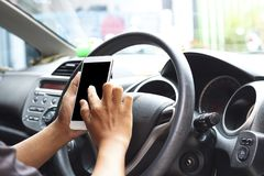 Man use phone and looking on empty screen of mobilephone, concept as looking way of street because of traffic jam, working in car stock photo