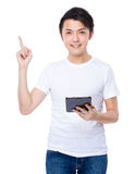 Man use of tablet and finger point up Royalty Free Stock Images