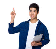 Man use of tablet and finger point up Royalty Free Stock Image