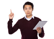 Man use tablet and finger up Stock Photos