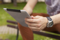 Man use tablet reading news and communicate on social networks Stock Photography