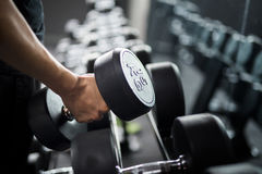 Man use weight training in Fitness center stock photography