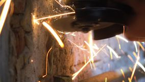 Man Used Circular Cutting Machine is Cut the Pipe with Lot of Sparks stock video
