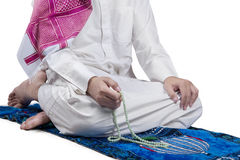 Man uses beads to dhikr Royalty Free Stock Photo