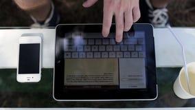 Man uses digital tablet stock video