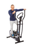 Man uses elliptical cross trainer. Royalty Free Stock Photo