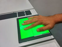 A man uses a fingerprint scanner for identification. Biometrics or cybersecurity concepts. Mobile shot with copyspace. Man uses a high-tech device for Royalty Free Stock Photography