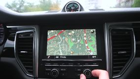 Man uses a gps navigator in the car stock video footage