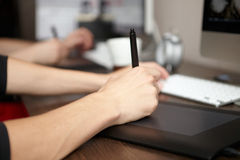 Man uses graphics tablet. Stock Image