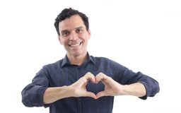 Man makes symbol of a heart. The person is wearing dark blue soc Stock Photos