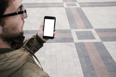 Man uses his Mobile Phone outdoor, close up. Man uses his Mobile Phone outdoor in the square, close up Stock Image