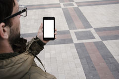 Man uses his Mobile Phone outdoor, close up Royalty Free Stock Images