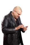 Man uses his touch screen mobile phone Stock Images