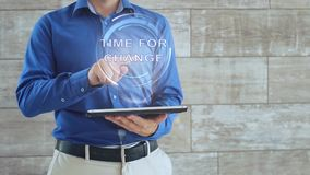 Man uses hologram with text time for change