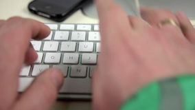 A man uses a keyboard stock video