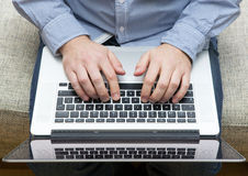 Man uses a laptop. Stock Photography