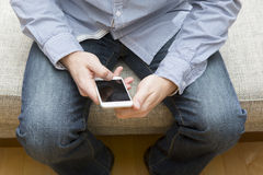 Man uses a mobile phone. Royalty Free Stock Photo