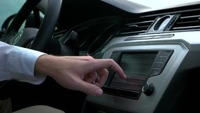 Man uses the multimedia in the car. Man uses the multimedia menu in the car stock footage