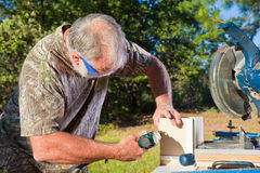 Man Uses a Nail Gun Stock Photography