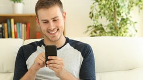 Man uses a smart phone at home stock footage