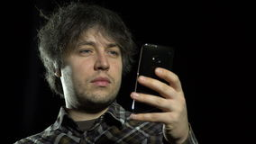 A man uses a smartphone stock video footage