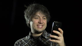 A man uses a smartphone stock footage