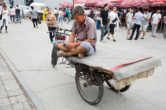Man uses a smartphone while on Panjiayuan Antique Market, Beijing stock photography