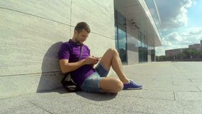 Man uses a smartphone in the summer city. Stock Photography