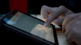 A man uses tablet. Man using digital tablet computer outdoor at rain weather stock footage