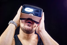 Man uses Virtual Realitiy VR head-mounted display. Man has fun using his Virtual Realitiy VR glasses head mounted display Stock Images