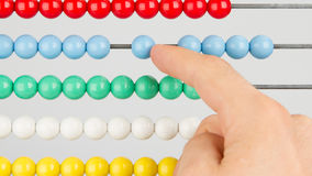 A man using an abacus on a white background Royalty Free Stock Images