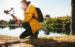 Photographer shooting video using a camera gimbal stock photography