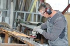 Man using angle grinder. Angle stock photo