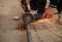 Man using an angle grinder. For cutting Royalty Free Stock Image