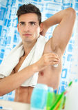Man using an antiperspirant Stock Photo