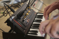 Man using antique analog synthesizer Royalty Free Stock Photos