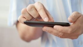 A man using apps on a mobile touchscreen smartphone. Concept of modern technology, shopping online and smart phones stock footage