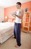 Man Using Arm Weights in Bedroom Stock Photo