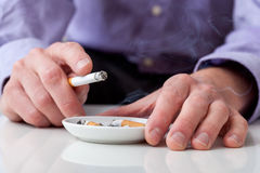 Man using ashtray Royalty Free Stock Photography