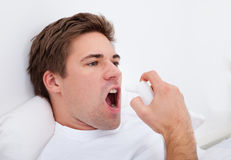 Man Using Asthma Inhaler Royalty Free Stock Photo