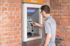 Man using ATM bank machine Stock Image