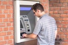 Man using ATM bank machine Stock Photos