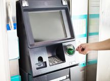 Man using atm machine with credit card Royalty Free Stock Photos