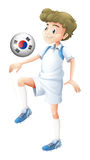 A man using the ball with the flag of South Korea Stock Image