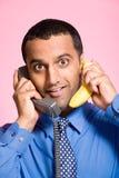 Man using a banana as a telephone Stock Photography