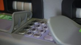 Man using banking cash machine - ATM. Man dials a pincode stock footage