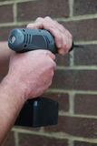 Man using a battery operated hand drill Royalty Free Stock Image