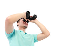 Man Using Binocular. Portrait Of A Young Man Using Binocular Over A White Background royalty free stock photo